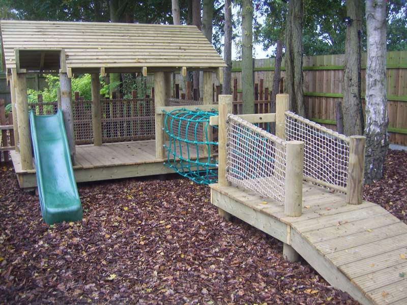 Treetops for the little ones with small rope bridge, tree house and slide